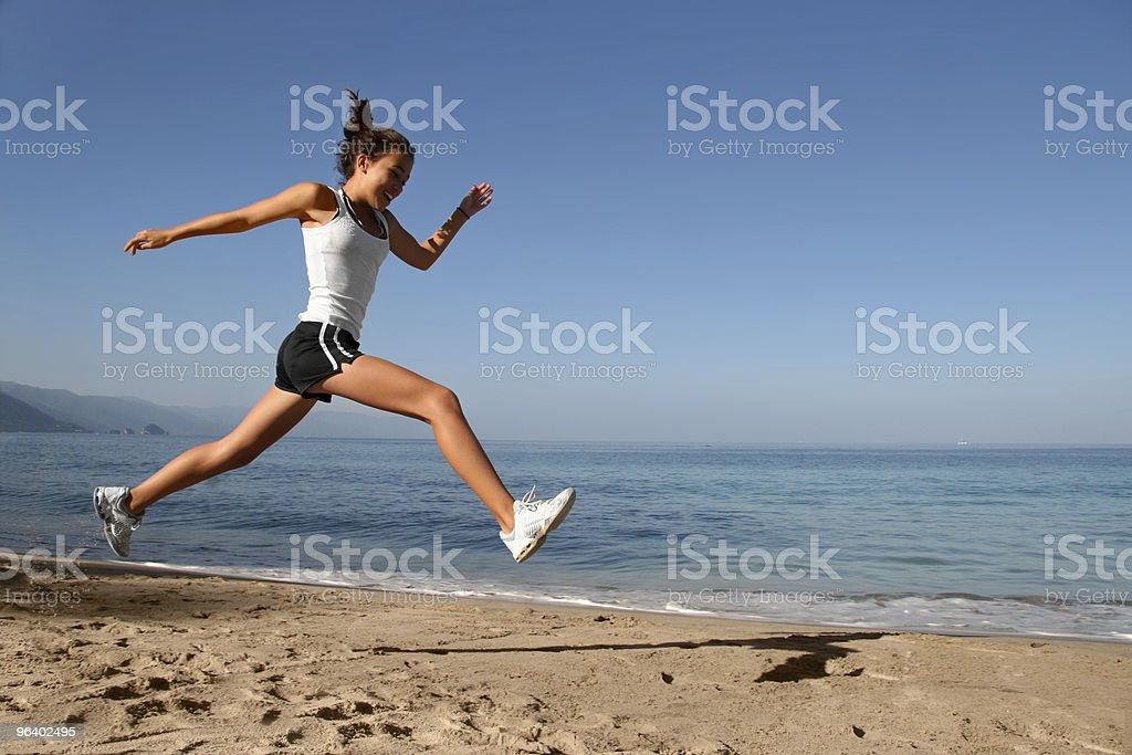 Jumping on the beach - Royalty-free Adolescence Stock Photo
