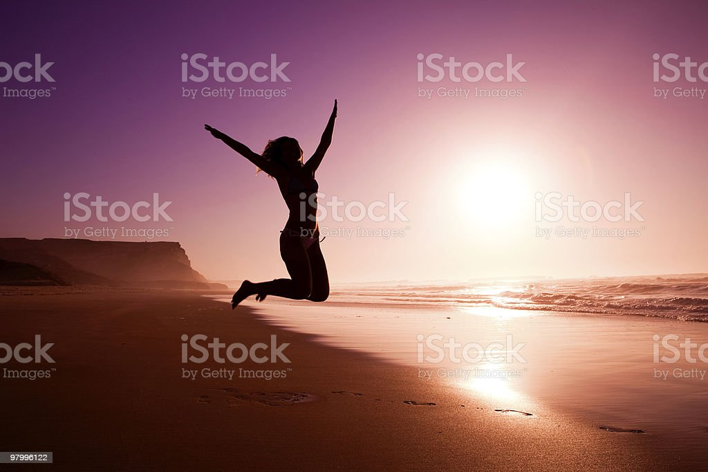 Jumping on the beach royalty free stockfoto
