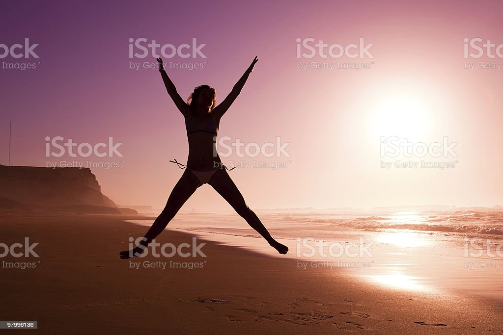 Jumping on the beach royalty-free stock photo