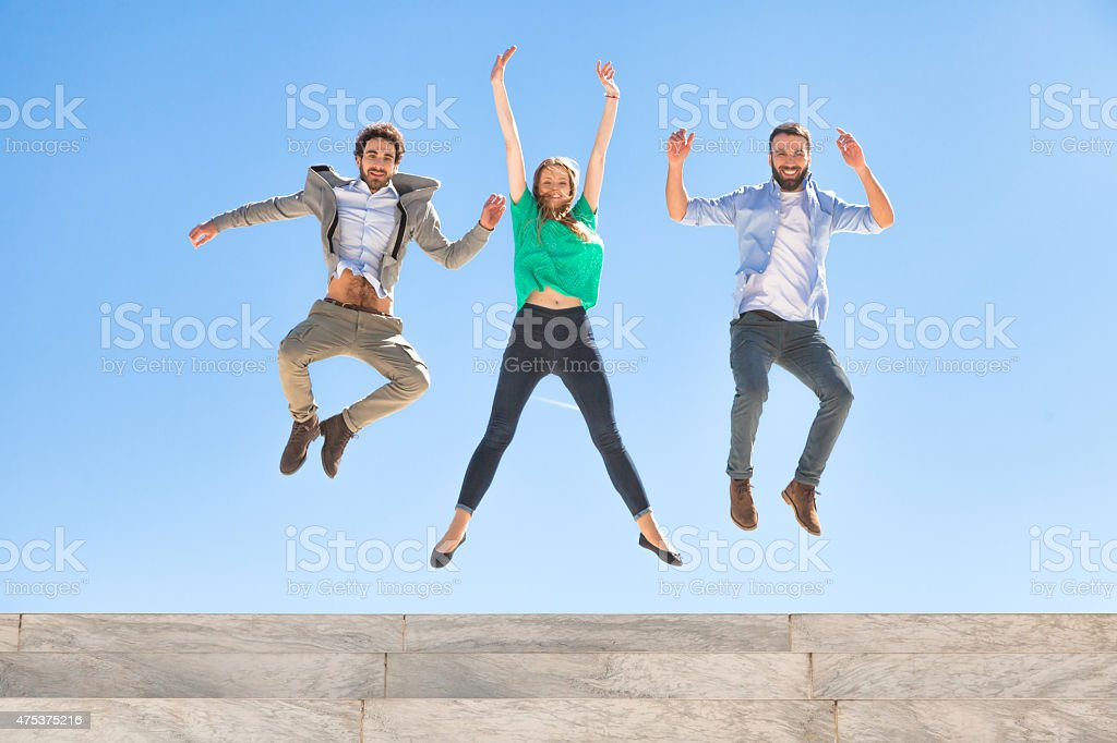 Jumping on the bleachers at the top of a stadium stock photo