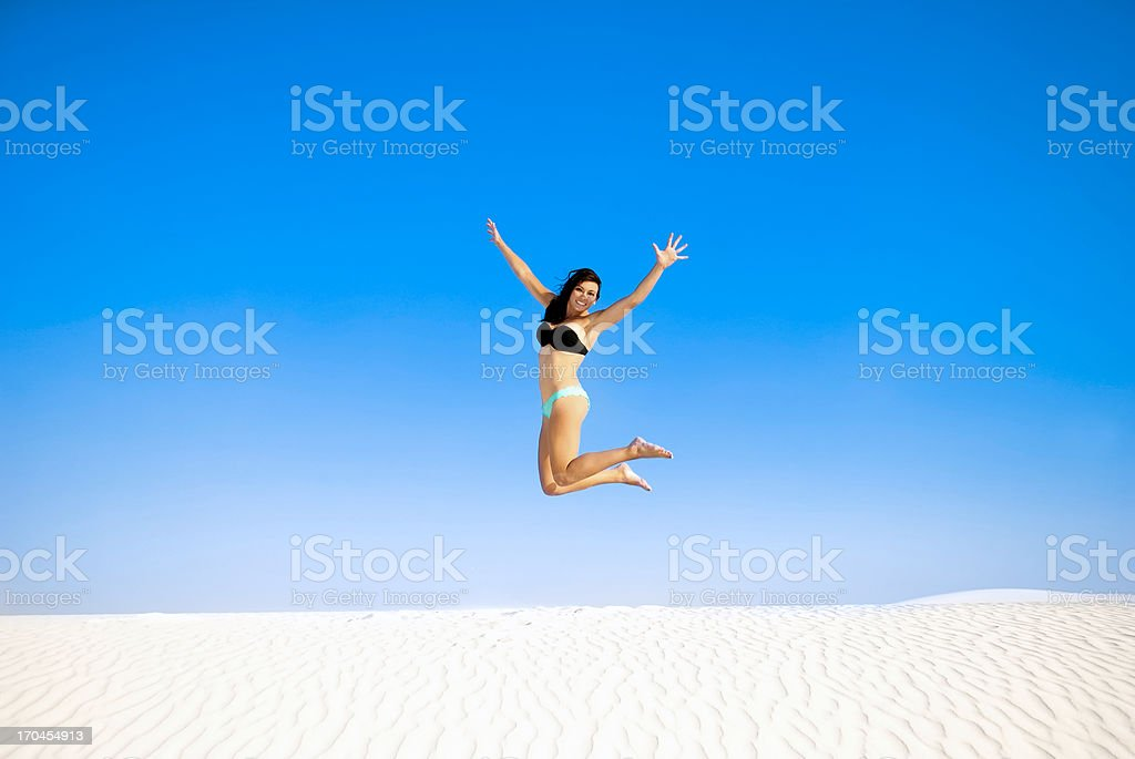 Jumping on the sand royalty-free stock photo