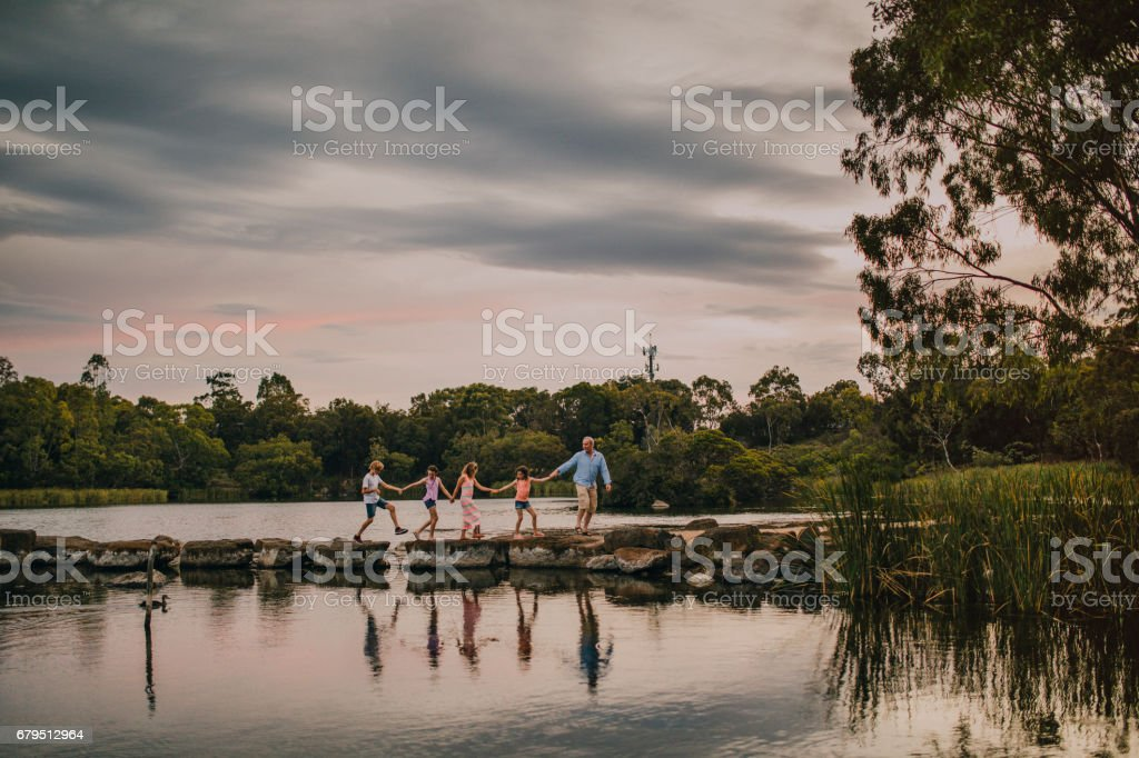 Jumping on the Stepping Stones stock photo