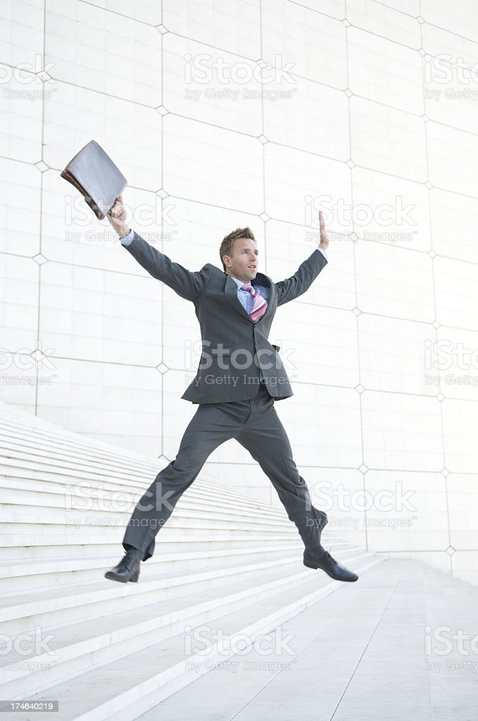 Jumping on White Steps stock photo