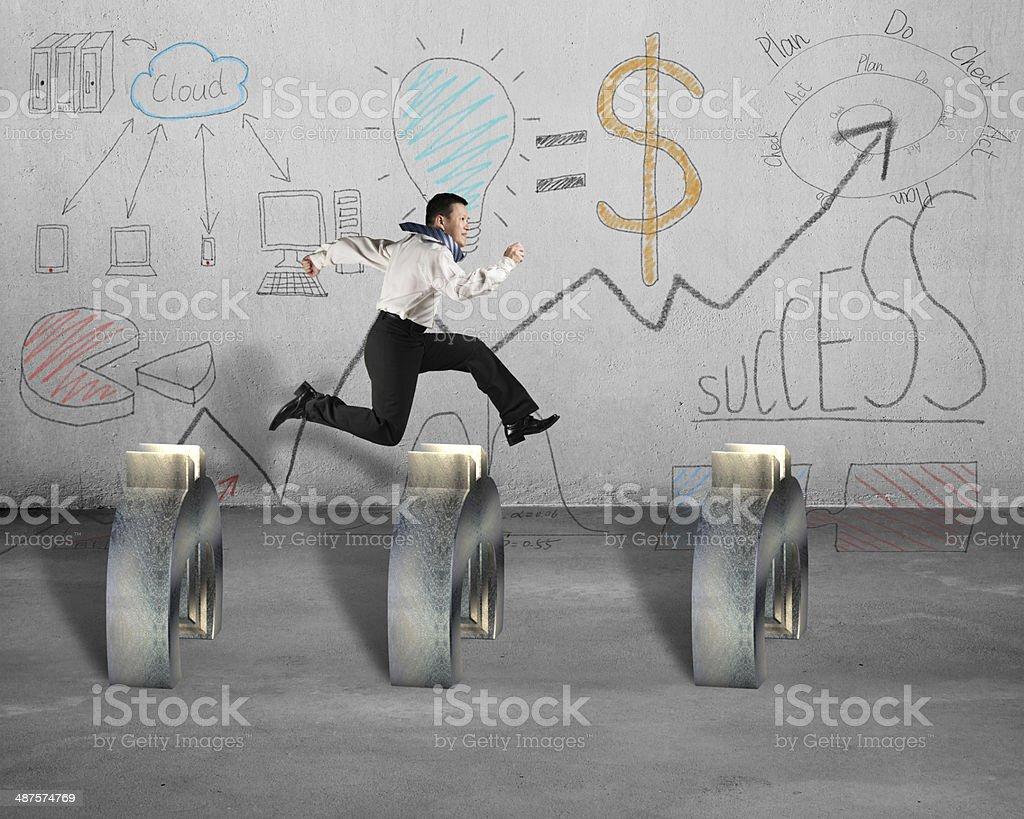 Jumping over Euro symbol with business concept doodles on wall stock photo