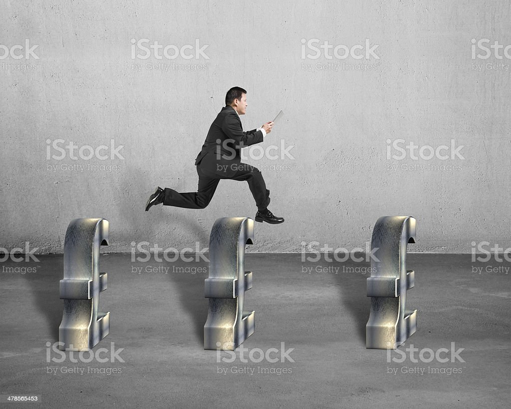Jumping over metal pound symbols stock photo