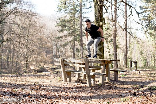 485902386istockphoto Jumping over the bench 947327414