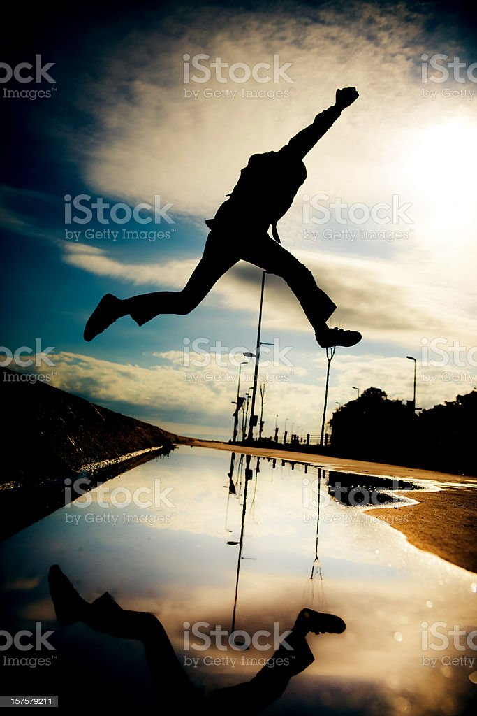 Jumping over the pond stock photo