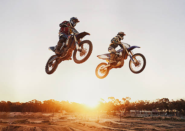 jumping over the sunset - extreme sports stock photos and pictures