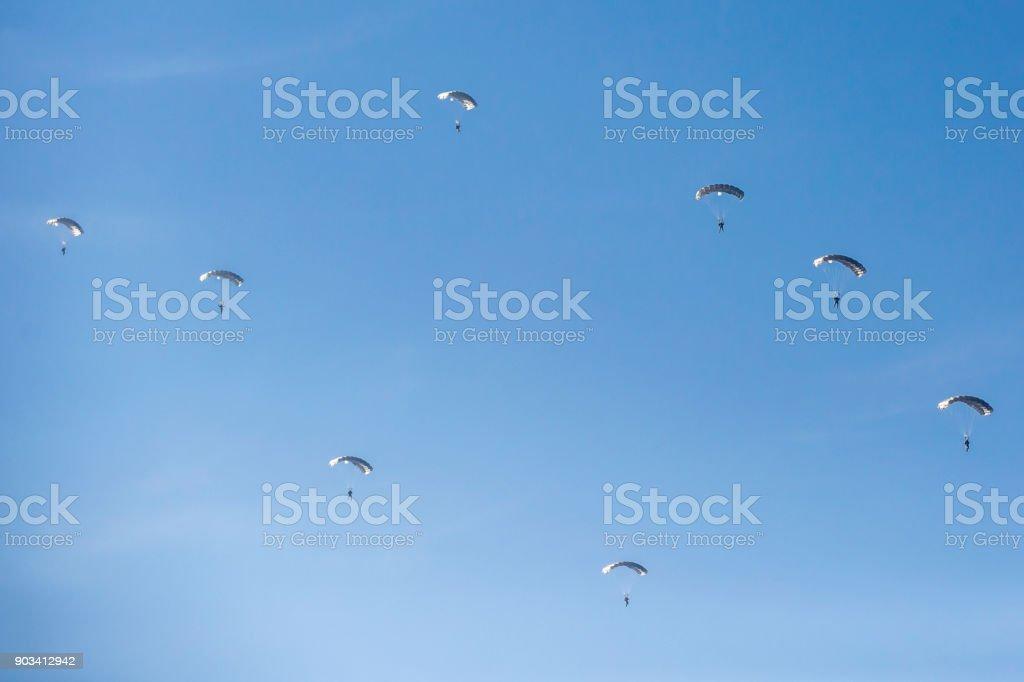 Jumping Parachutists stock photo