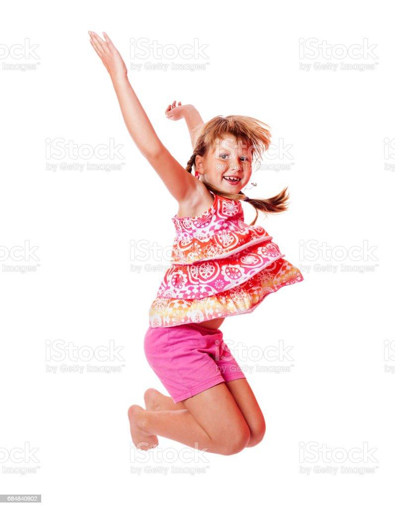 Jumping school girl стоковое фото
