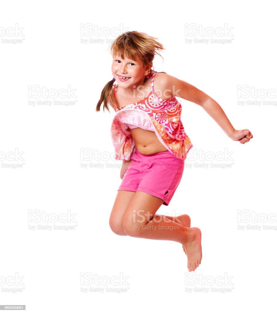 Jumping school girl Lizenzfreies stock-foto