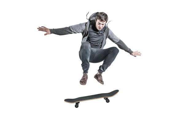 Jumping skateboarder isolated stock photo