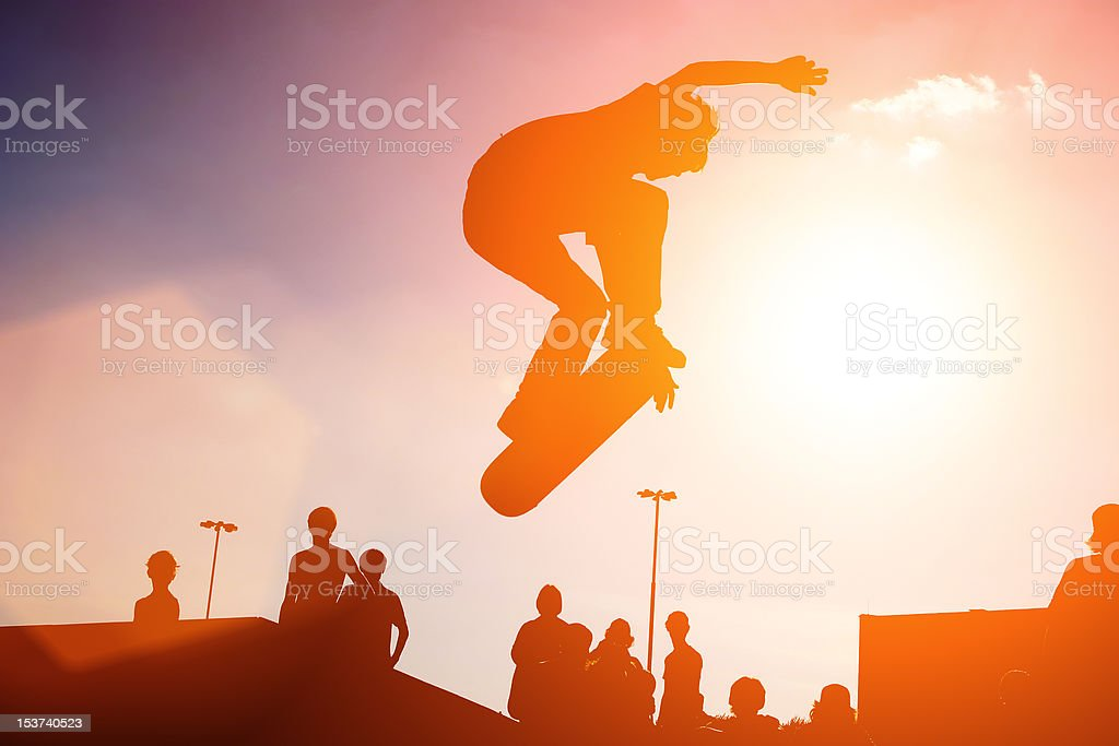 Jumping skateboarder stock photo