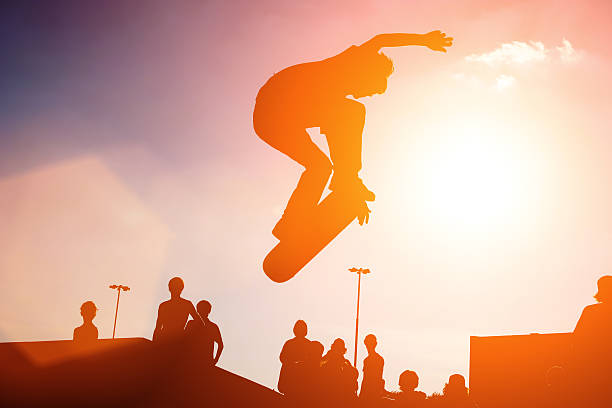 Jumping skateboarder stock photo