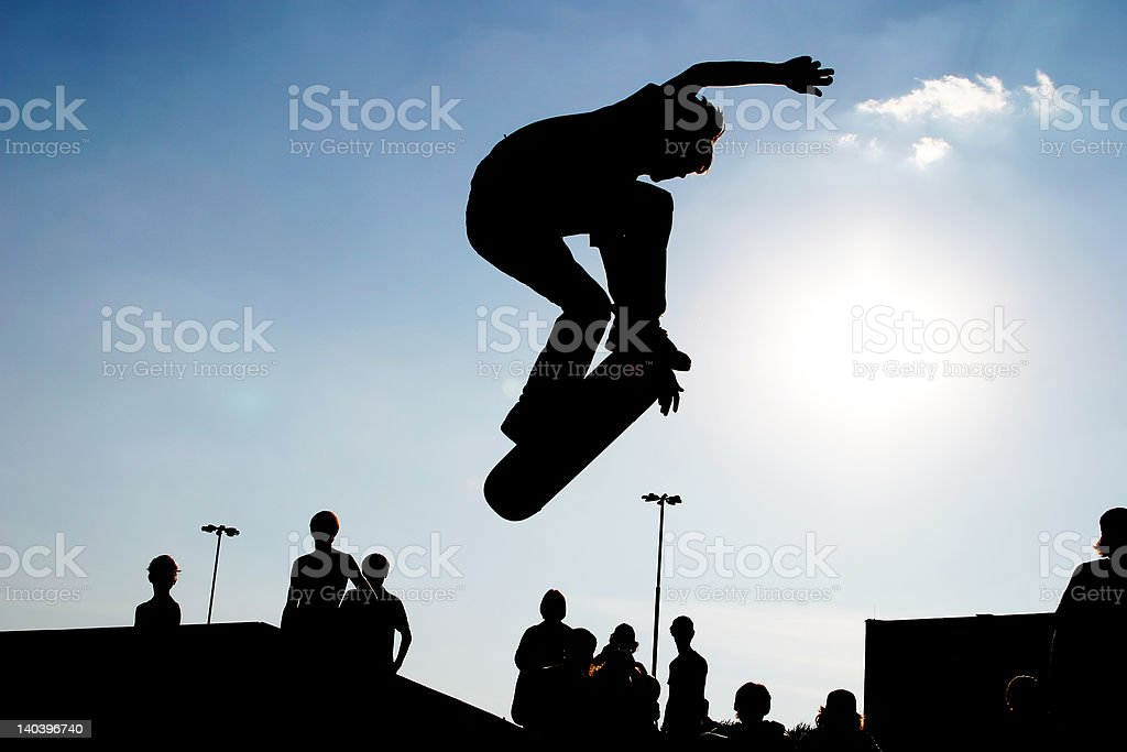 Jumping skateboarder silhouette stock photo