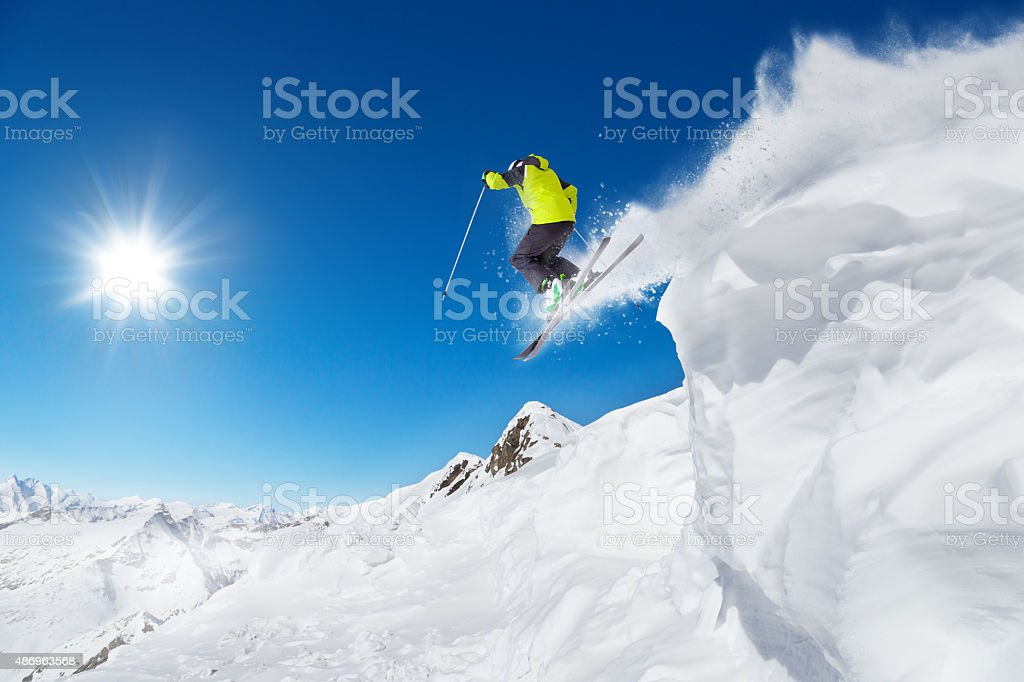 Jumping skier at jump stock photo