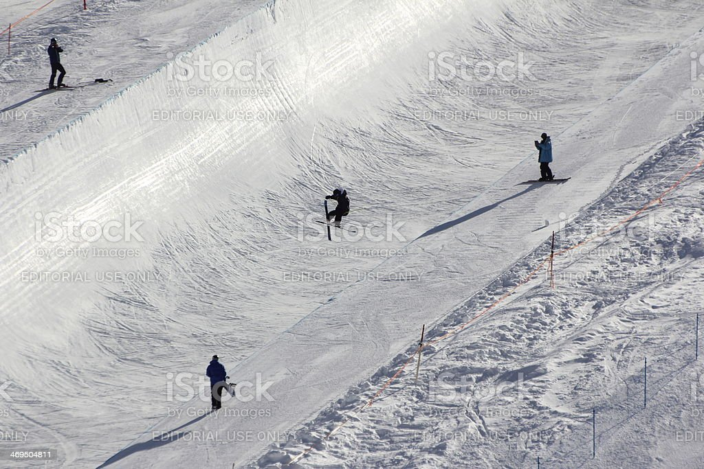 Jumping Skier in Halfpipe, Skiing, Freestyle, Winter Season stock photo