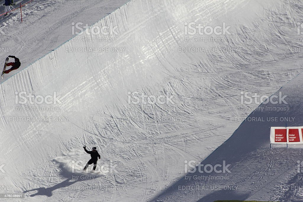 Jumping Snowboarder in Halfpipe, Snowboarding, Freestyle, Winter Season stock photo