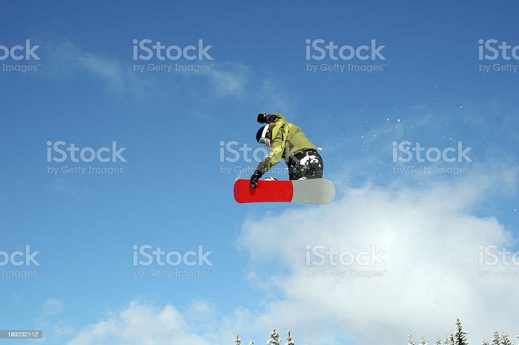 Jumping snowboarder stock photo