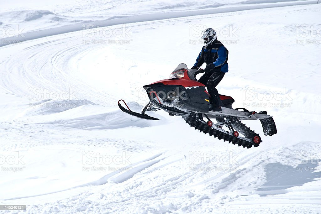 Jumping snowmobile stock photo