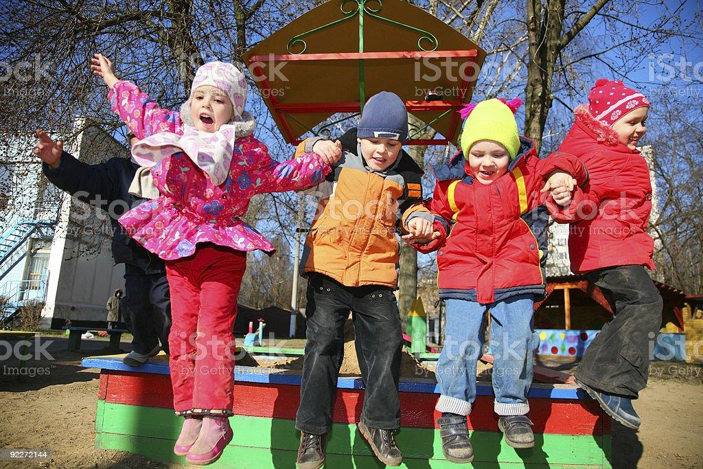 jumping team in kindergarten royalty-free stock photo