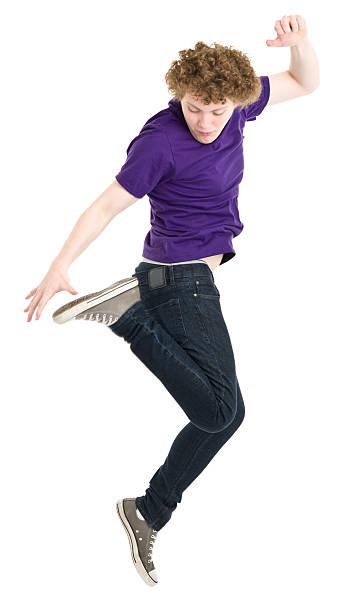 jumping männlicher teenager - geek t shirts stock-fotos und bilder