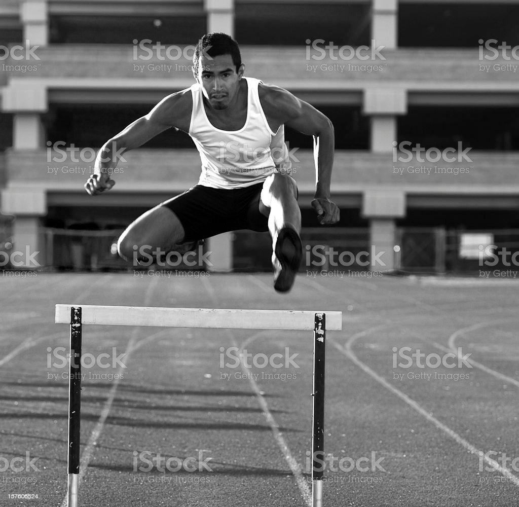 Jumping the Hurdle royalty-free stock photo