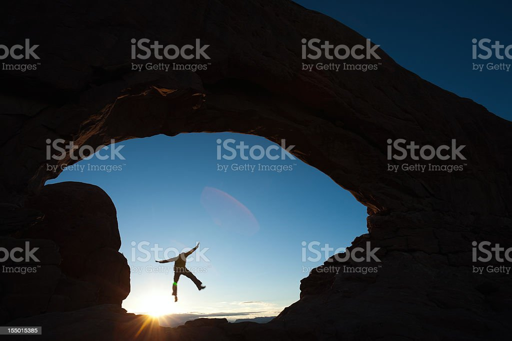 Jumping through South Window Arch. royalty-free stock photo