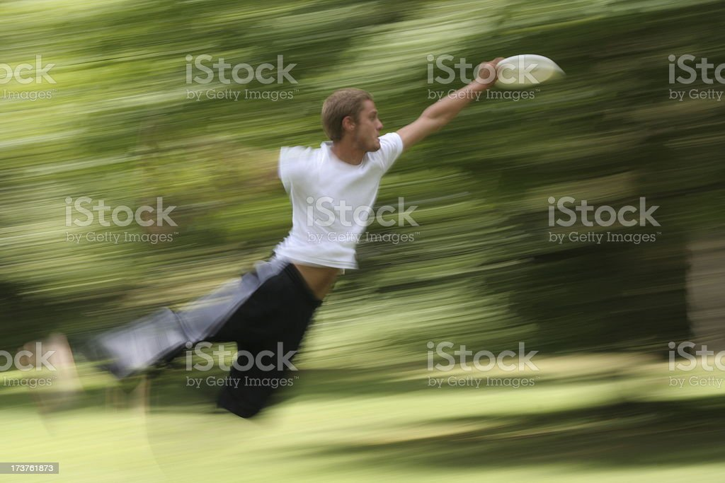 Jumping to Catch a Frisbee royalty-free stock photo