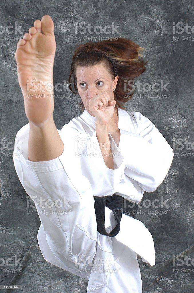 Jumping to kick royalty-free stock photo