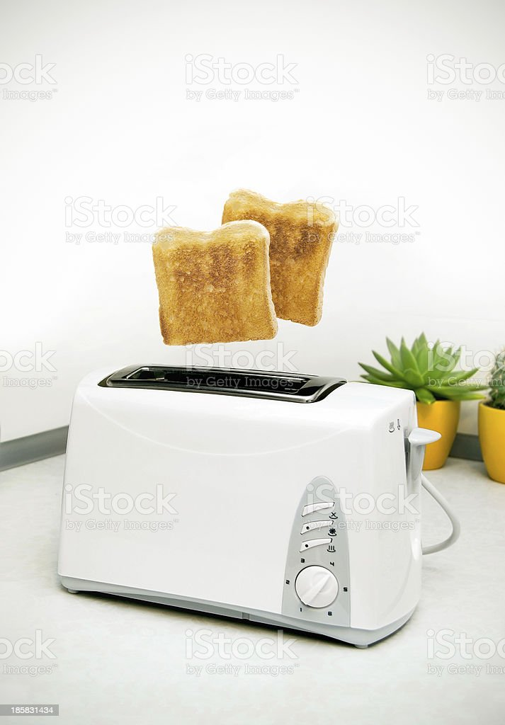 Jumping toasts. Prepare breakfast in kitchen royalty-free stock photo
