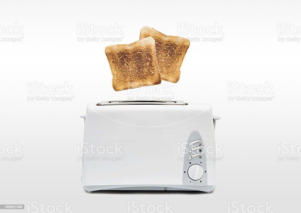 Jumping toasts. Preparing breakfast in modern toaster stock photo