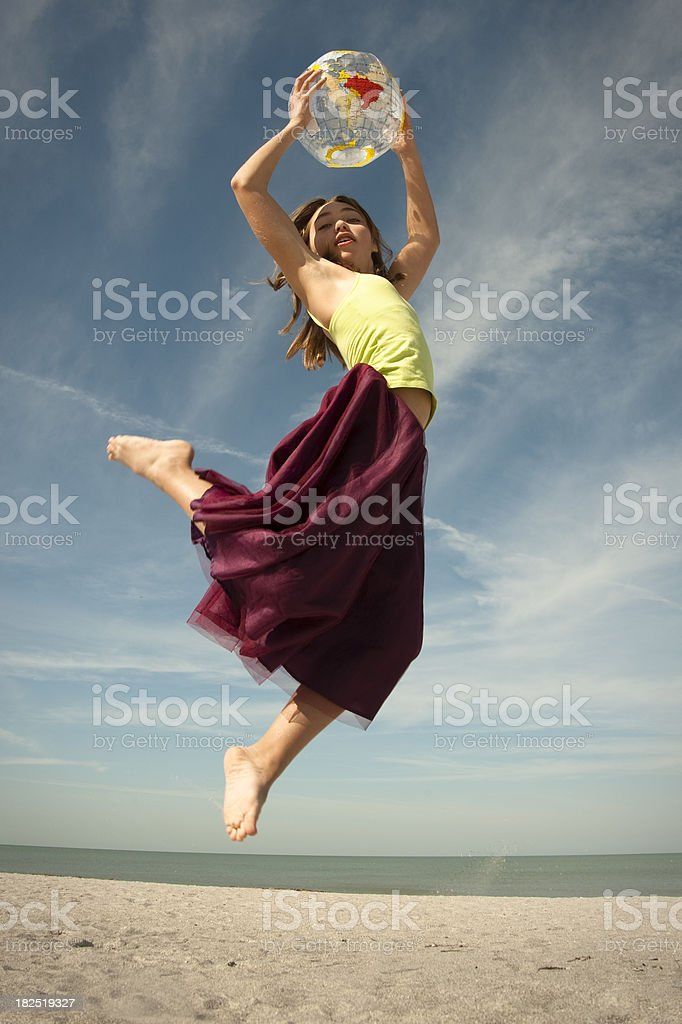 Jumping with a balloon planet serie. royalty-free stock photo