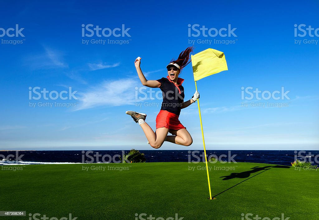 jumping with golf ball stock photo