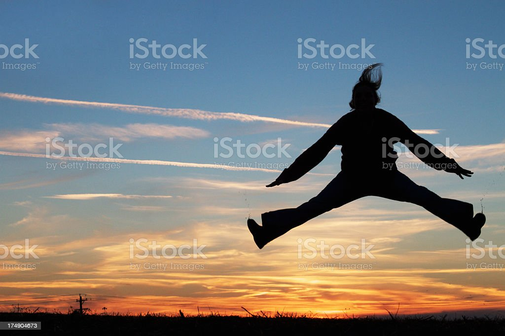 Jumping Woman Silhouette royalty-free stock photo