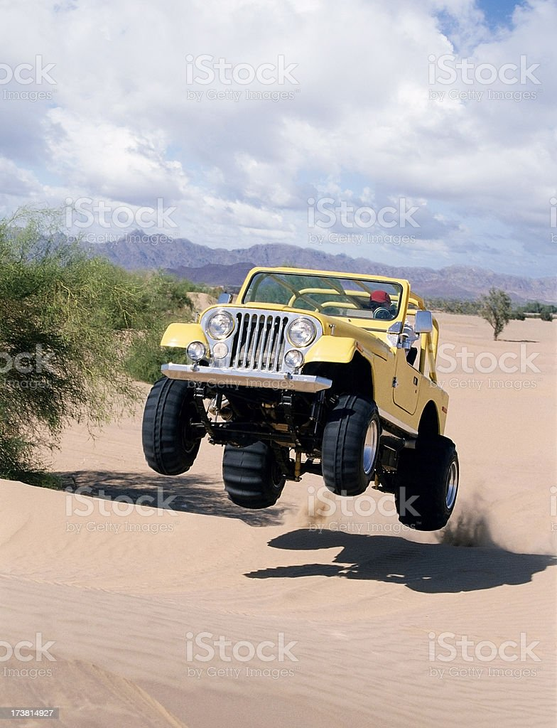 Jumping Yellow Jeep stock photo
