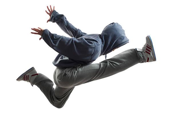 junge frau tänzer springen - marko skrbic stock-fotos und bilder