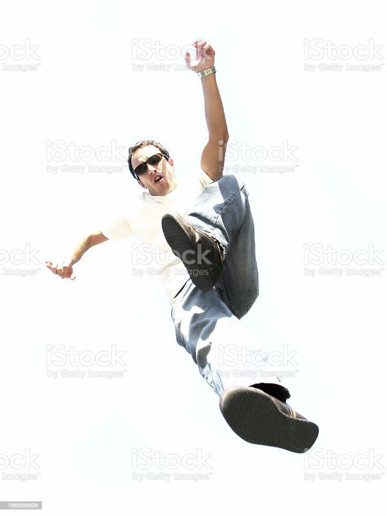 Jumping young man (overexposed) royalty-free stock photo