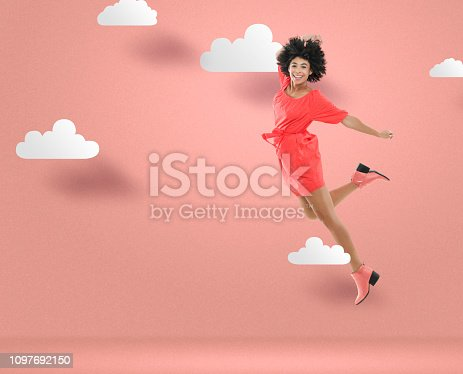 Jumping young woman in dress