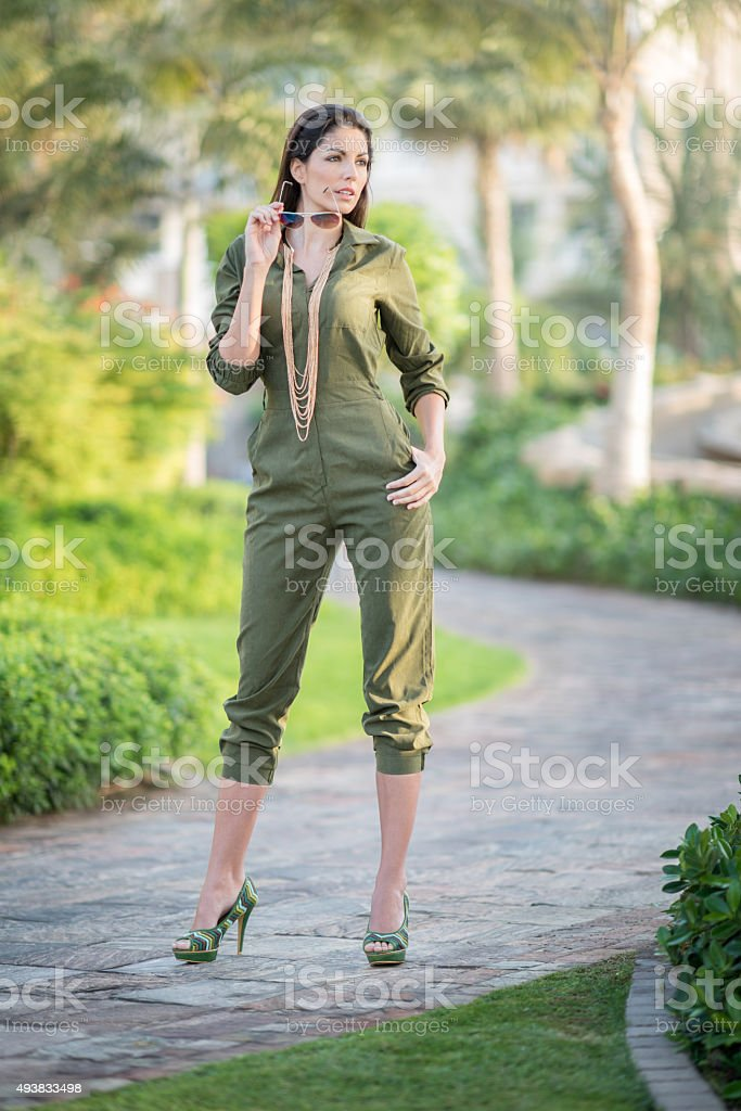 Jumpsuit Fashion, Model posing Outdoor in Heels stock photo