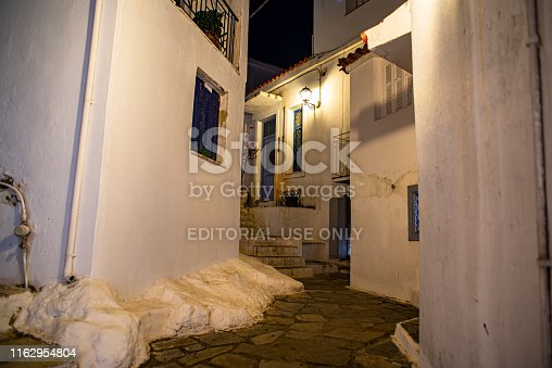 Skiathos, Greece - Jun 03, 2019: Night image of the beautiful old town on the Mediterranean island Skiathos