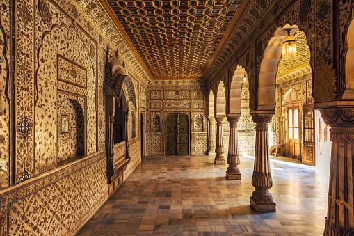 Junagarh Fort Bikaner Rajasthan - Interior gold artwork with architecture details.