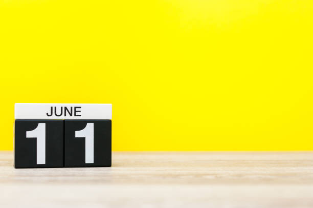 June 11th. Day 11 of month, calendar on yellow background. Summer day. Empty space for text. World Wide Knit in Public Day stock photo