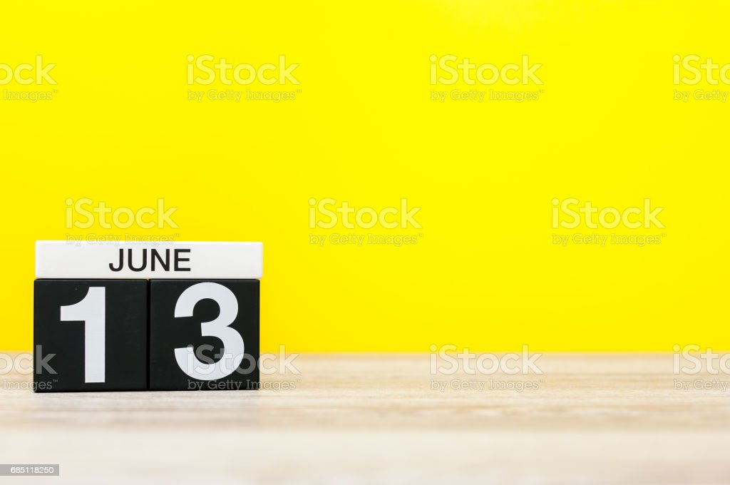 June 13th. Day 13 of month, calendar on yellow background. Summer day. Empty space for text. World Wide Knit in Public Day royalty-free stock photo