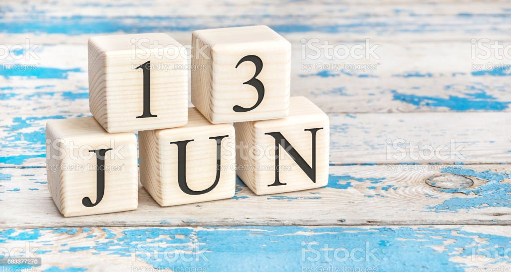 June 13th. Wooden cubes with date of 13 June on old blue wooden background. stock photo