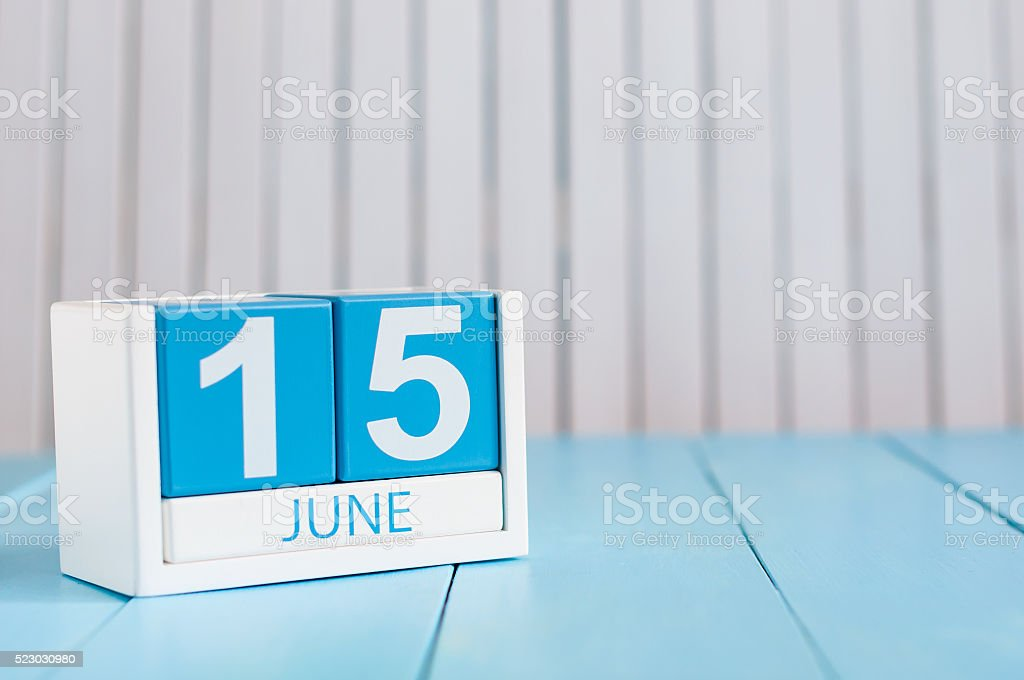 June 15th. Image of june 15 wooden color calendar on stock photo