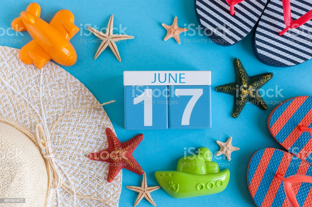June 17th. Image of june 17 calendar on blue background with summer beach, traveler outfit and accessories. Summer day stock photo