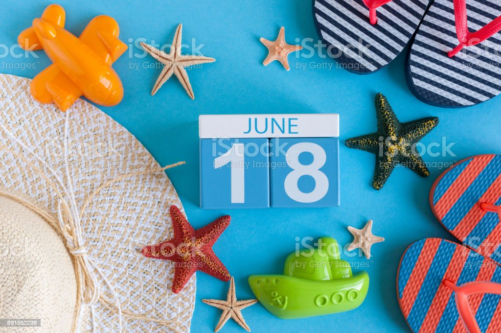 June 18th. Image of june 18 calendar on blue background with summer beach, traveler outfit and accessories. Summer day stock photo