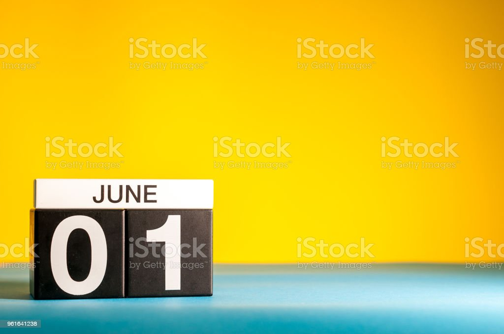 June 1st. Day 1 of june month, calendar on table with yellow background. Summer time, empty space for text stock photo