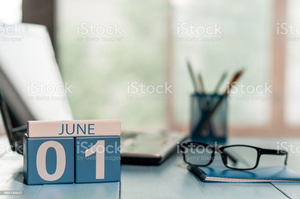 June 1st. Day of the month 1 , wooden color calendar on business workplace background. Summer concept. Empty space for text stock photo